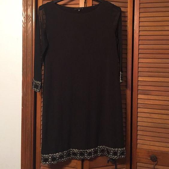 Tiana B dress Beautiful little black dress with shear sleeves Tiana B.  Dresses Long Sleeve