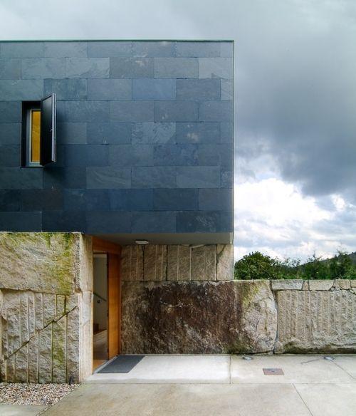 Raw quarried blocks and black slate cladding, Carlos Quintans