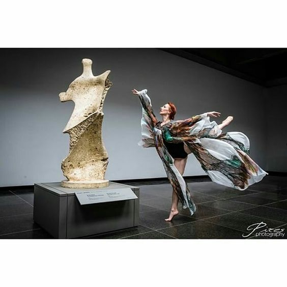 A breathtaking work of art by @Emanuel Pires and model @laynabrett at the #ago in the #WithLoveLingerie phoenix robe.