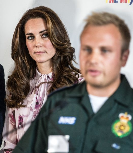 "Catherine, Duchess of Cambridge listens to ambulance man Dan Farnworth speak of his mental ordeal following witnessing a traumatic situation at a reception of the""Heads together"" on World Mental Health Day on October 10, 2016 in London, England.:"