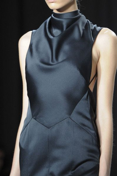 Jason Wu Fall 2014 - Fashion design details. Deep dark blue charcoal grey black silk with high cowl loose neck.