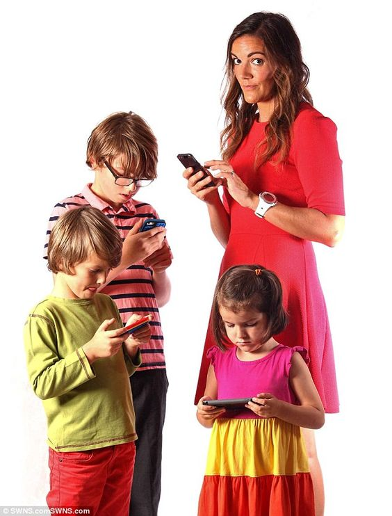Clare O'Reilly's, above, phone addiction has spread to her kids, left to right, Sammy and Eddie and Aneila http://www.dailymail.co.uk/femail/article-3255261/They-rage-against-mobiles-wrecking-family-meals-t-Hypocritical-parents-turning-children-phone-addicts.html