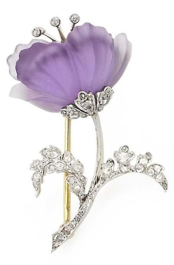 An early 20th century amethyst and diamond flower brooch, by Plisson & Hartz. The carved amethyst flowerhead, with a single-cut diamond stamen and rose-cut diamond leaves, maker's mark, French assay mark.