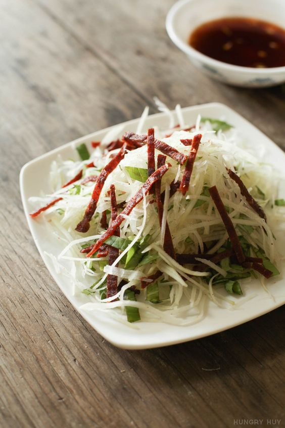 An easy 3-ingredient Vietnamese papaya salad you can make in a few minutes. There's no cooking required, just easy prep so you can get to snacking! Recipe at: http://www.hungryhuy.com/vietnamese-papaya-beef-jerky-salad/