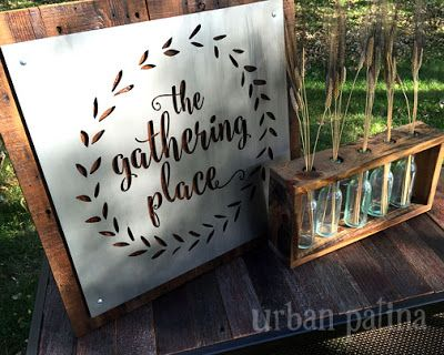 The gathering place metal sign on salvaged wood
