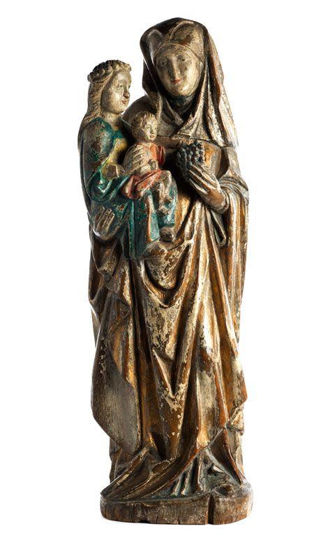Höhe: 73 cm. Mittelrhein, in der nachwirkenden Spätgotik um 1600. Nussholz, geschnitzt, gefasst und im Kleid teilvergoldet. Standfigur der Heiligen Anna auf...