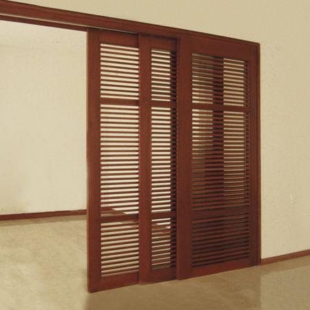 Sistema corredizo colgante sincronizado para puertas de - Puerta corrediza madera ...