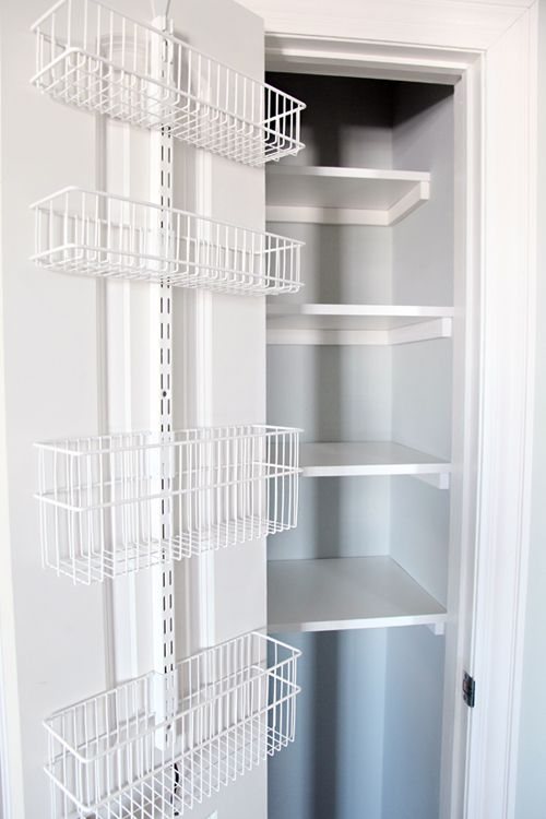 Back of Closet Door is organized with Container Store Elfa unit.    Organized Linen Closet