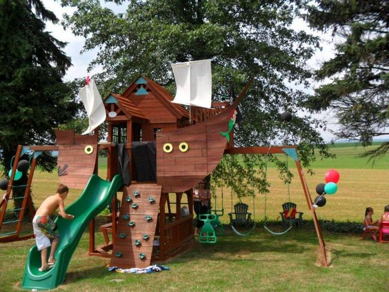 The pirate ship I made for my nephew's b-day.  I converted the swingset into a pirate ship, complete with home-made sails and pirate flags.  He loved it!