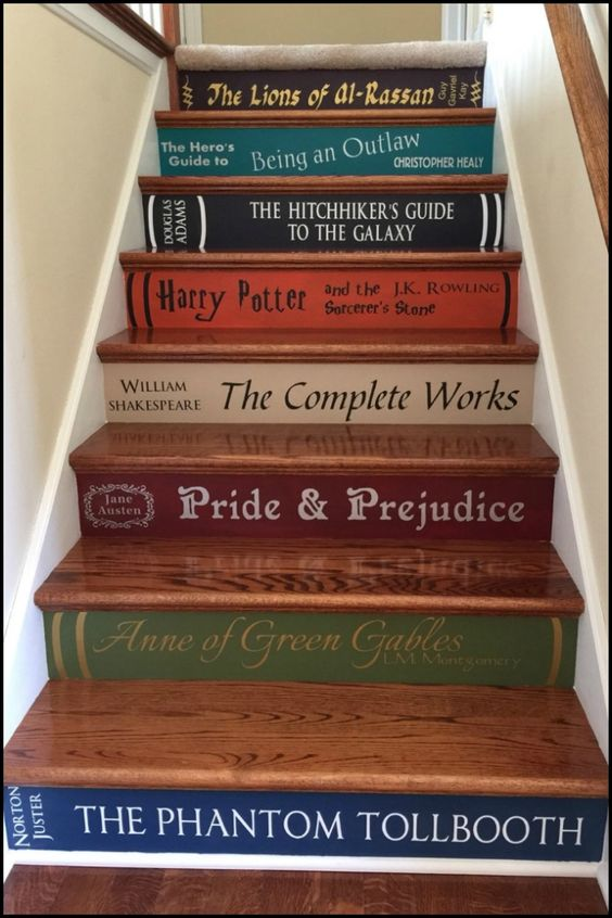 Personalize your stairs by painting It with the spines of your favourite book covers!