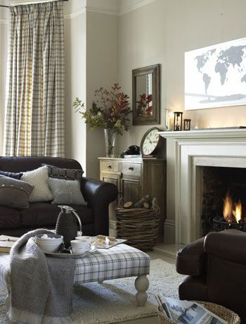 This is a great traditional scheme with the off whites, footstool and tartan accessories.