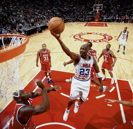 Michael Jordan attacks the basket in his 14th and final All-Star Game in 2003. Jordan started the game when Vince Carter offered him his starting spot, and seemed poised to have the game winner with a baseline jumper with 4.8 seconds remaining in overtime. Instead, Jermaine O