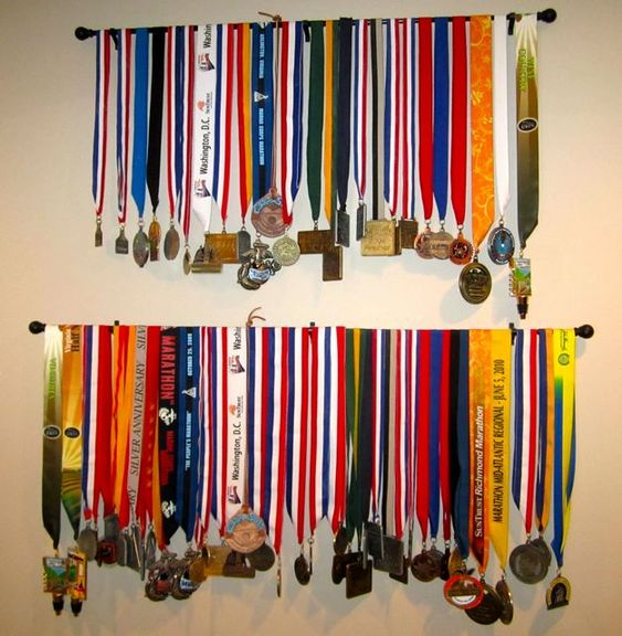 Curtain rods soccer and race bibs on pinterest for Curtain display ideas
