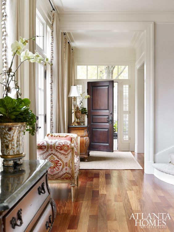 Large Foyer Window : Classical moldings a raised panel door and large windows