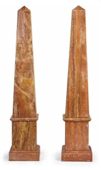 A PAIR OF ROUGE MARBLE OBELISKS, Modern ; On square plinths - Dim: 78 ½ in. (199.5 cm.) high