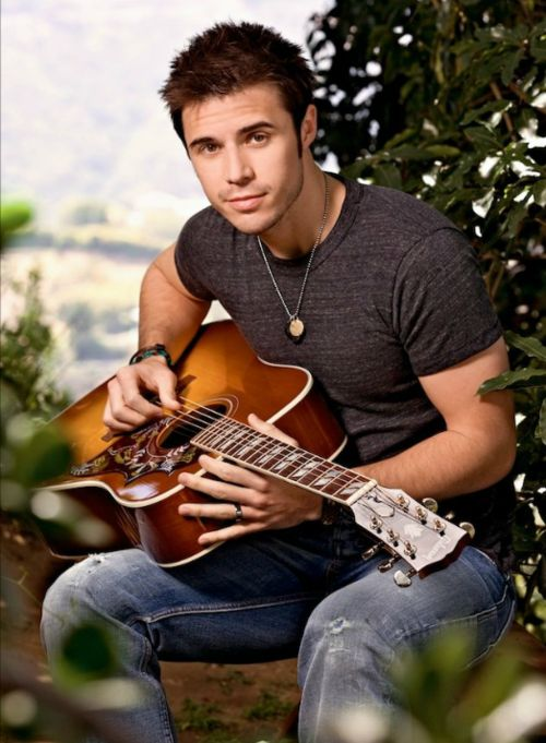 """American Idol winner Kris Allen from 2009. He sang the crap out of Donna Summers """"She Works Hard For the Money."""""""