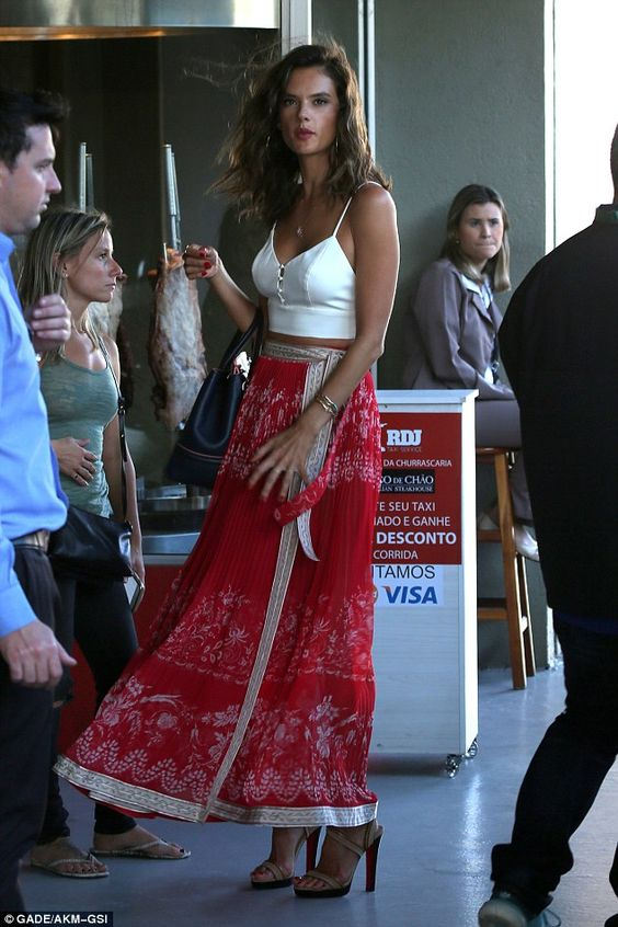 Back home: The Victoria's Secret model added a black handbag and towering sandals