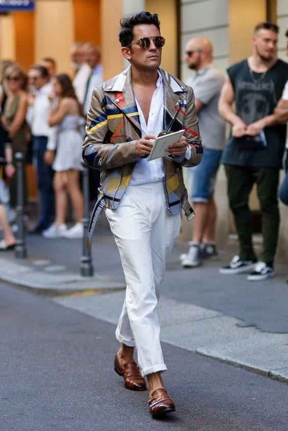 A summer trend-let menswear outfit with white trousers spotted during Milan fashion week 2017.