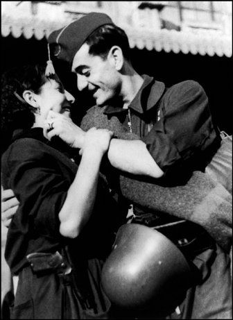 Spanish Civil War: Bidding farewell before getting on a military train directed to the Aragon front, August 1936. ROBERT CAPA