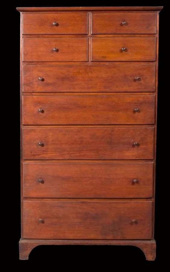Shaker Tall chest, 1820, wonderful scale, classic form, well thought out proportions, graduated drawers, moulded edges inside and out, and lovely dovetailed construction. Golden nut brown mellow patina. Constructed primarily with pine with its original hardwood knobs and original oxblood stain which greatly enhance the importance of this rare form of American Shaker craftsmanship