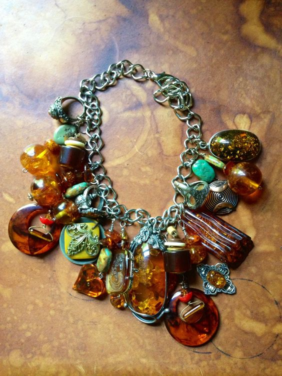 Combined all of my Amber jewelry and made this necklace. Added some old earrings and buttons also.