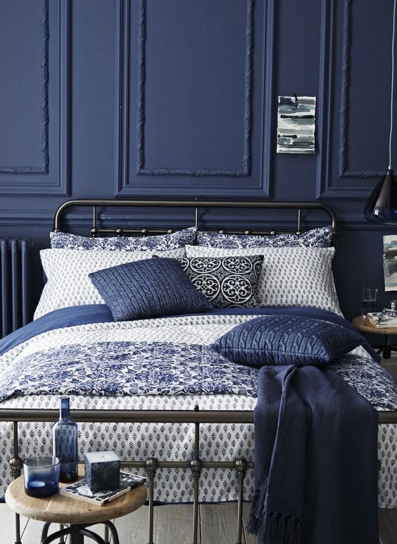 Navy walls give your rooms a designer look, especially when combined with a variety of blue and white print fabrics.: