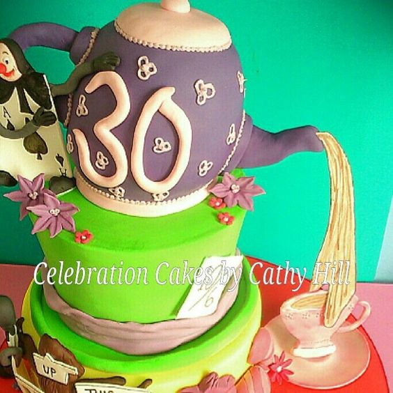 Close up of top tier. Mad Hatter tea party cake.