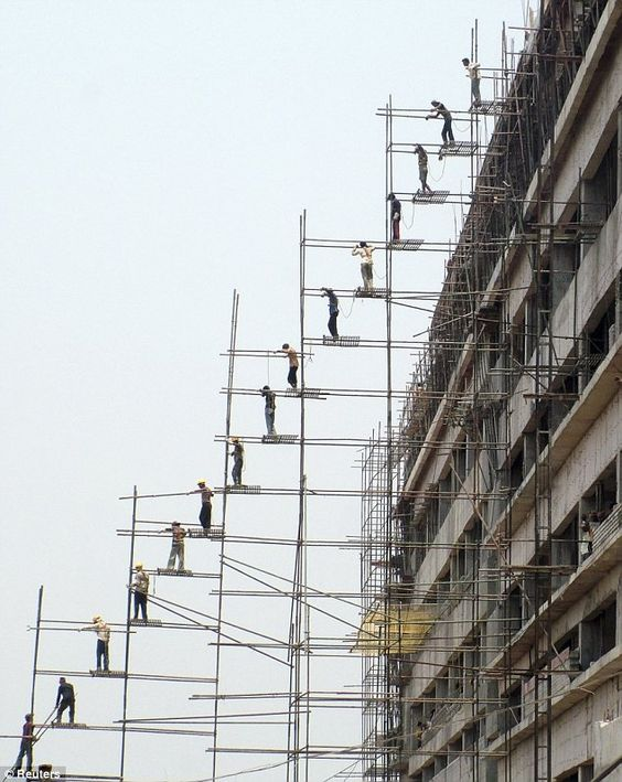 India - Extreme scaffolding for transporting material manually.