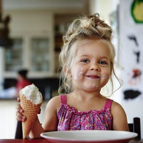 Little girl eating ice cream; messy
