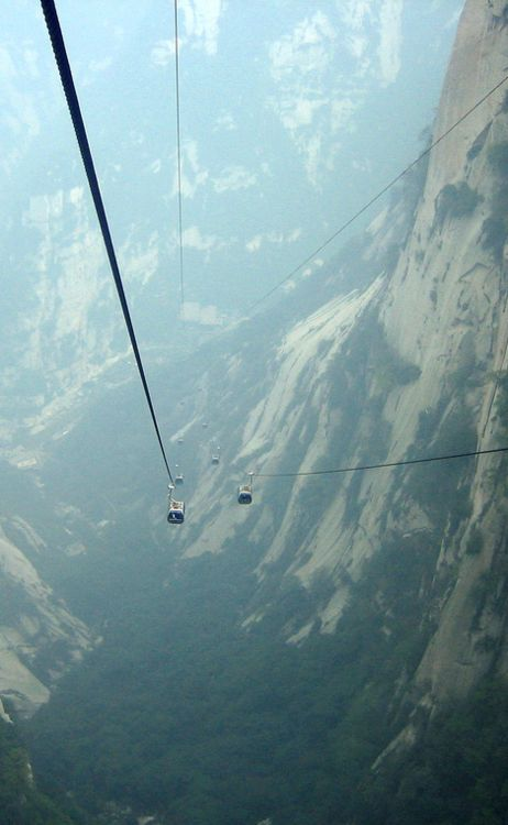Cable ride at Hua Shan - it has five main peaks, with the 2160m (7086ft) tall South Peak being the highest.   Hua Shan is located roughly 100km East of the city of Xi'an in China's Shaanxi Province.
