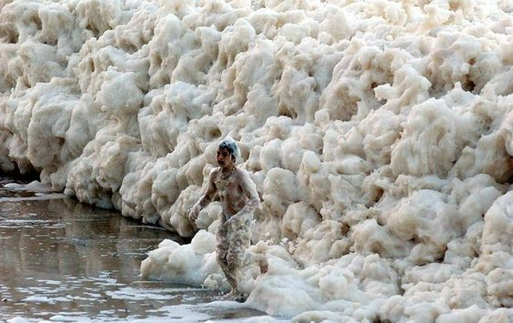 Ocean foam at Australia's beaches    This weird phenomenon happened off the coast of Yamba in New South Wales, Australia. Scientists say the foam is caused by all kinds of impurities, such as chemicals, plants, salts etc. Due to its low density and persistence, foam can be blown by strong on-shore winds from the beachface inland onto sidewalks and streets.