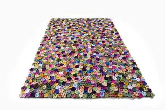 Crochet RUG Inspiration ~ cut a rectangular sized piece of rug gripper material {found at almost all retail stores , i.e., target, walmart, loews, etc.} + hundreds of crocheted flower motifs stitched onto the rug gripper  = a fun and unique rug!