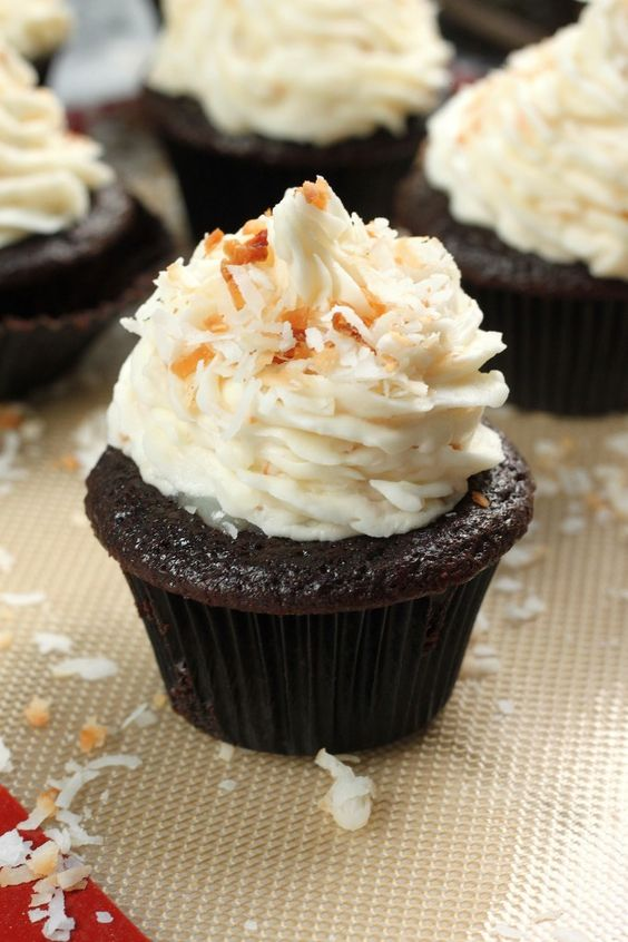 The Best Chocolate Coconut Cupcakes - Moist, tender Chocolate Cupcakes topped filled with Coconut Cream, and topped with Coconut Buttercream AND Toasted Coconut. These are a coconut lovers dream!