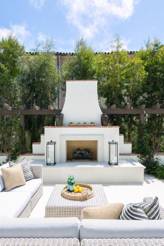 Beautiful modern coastal patio design idea with fireplace