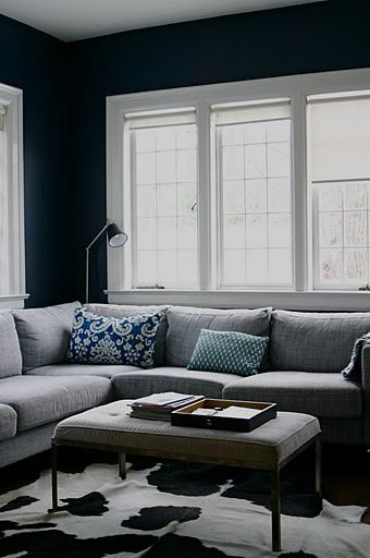 Cowhide Rug Makes A Room With Navy Walls Not So Serious