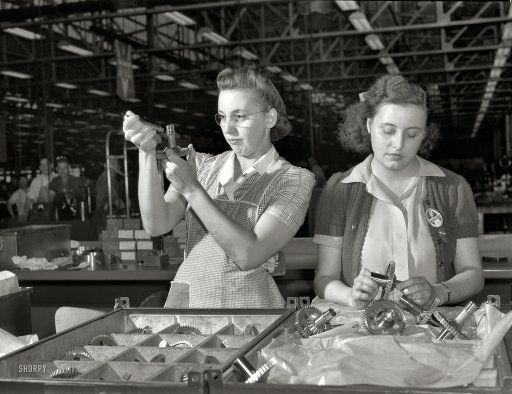 """July 1942. """"Production of aircraft engines at Melrose Park Buick plant near Chicago. Hundreds of gears pass through the expert hands of Dorothy Miller and Sylvia Dreiser during their eight-hour working day in a large Midwest aircraft plant. Inspection of these vital cogs in America's war machine is a delicate task and one which requires infinite patience and precision."""" Medium format negative by Ann Rosener for the Office of War Information. View full size."""
