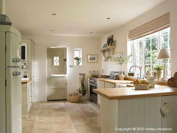 country kitchen | cupboards painted in Farrow and Ball Shaded White | a soft neutral tone with a touch of beigey green | Natural Calico