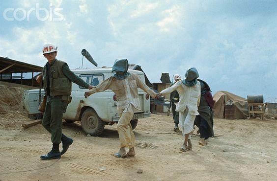 viet cong girls | ... MP Leading Captured Viet Cong in Hoods — Image by © Bettmann/CORBIS