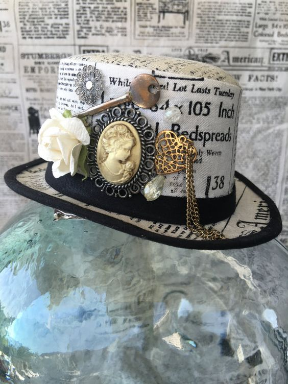 Available on etsy.com/shop/arcaniumdesign : Steampunk Mini Top Hat Fascinator - Newsprint with Cameo & Embellishments