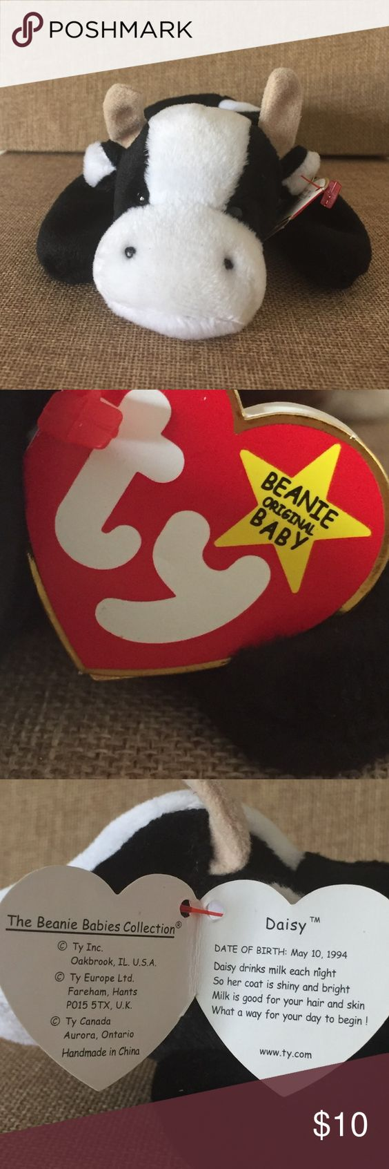 Beanie Baby Daisy 1994 5th Generation. Beanie Baby Daisy 1994 5th Generation. New as the day she came home. Her hang tag has light wear as she was a gift and a price tag was taken off. ** hang tag featured is not true Hang tag** P.E. pellets. She is part of a large 200 plus collection. Beanie Baby  Other