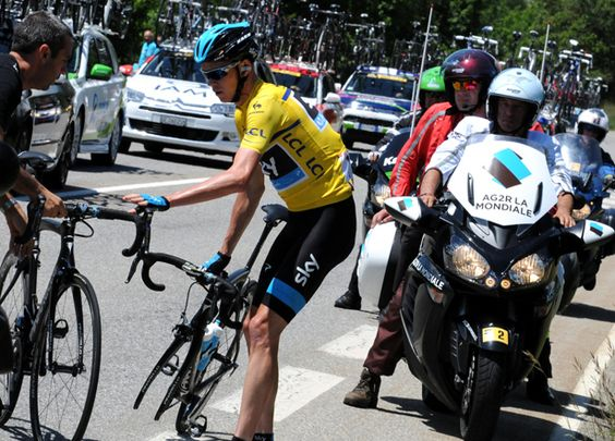 Best Photos of the 2014 Dauphiné Criterium | Froome Struggles - A Stage 4 mechanical was the first sign that Chris Froome's fortunes were turning in the Dauphiné Criterium. A crash on Stage 6 would complicate matters even more.