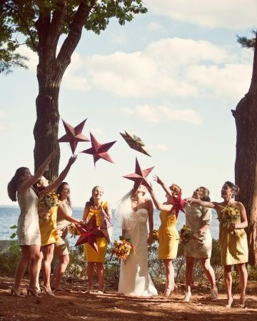 Bridesmaids wore mismatching yellow and cream dresses while tossing star lanterns above the bride
