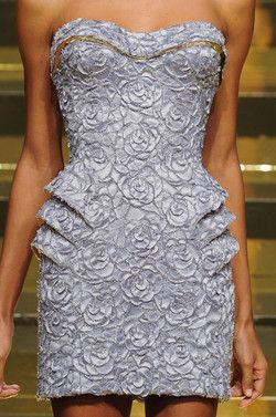 Love this Versace piece with the texture and the tiered pockets.