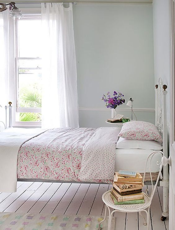We love this simple, yet chic bedroom reveal. Rustic details like antique white furniture and accessories pair perfectly with a pretty pink floral bedspread.