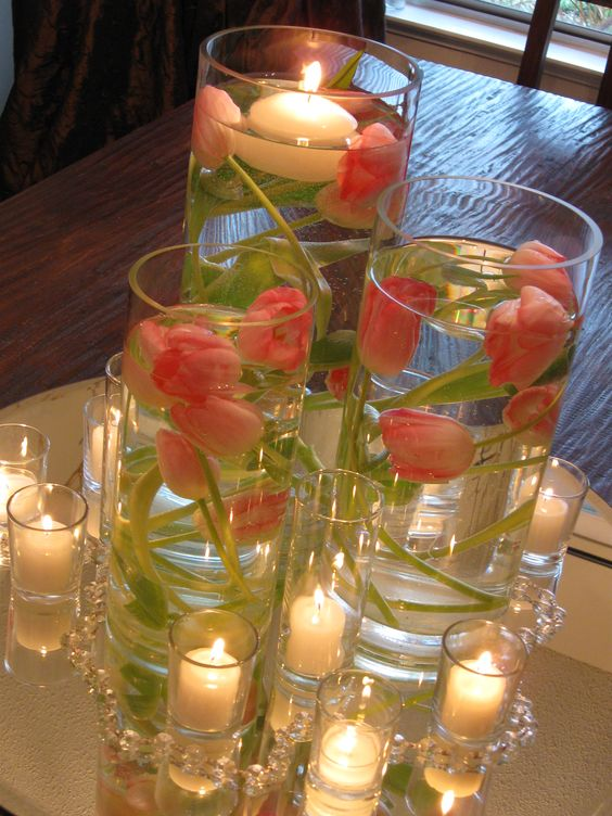 Cluster style centerpiece of pink tulips submerged in