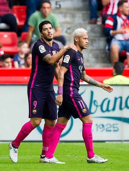 Luis Suarez of FC Barcelona celebrates with his teammate Neymar of FC Barcelona after scoring the opening goal during the La Liga match between Real...