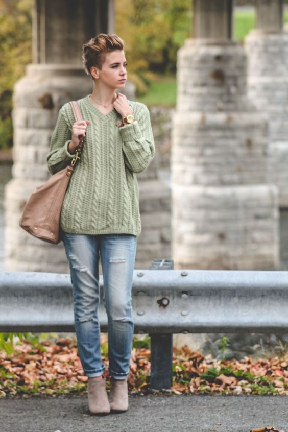 A green knit jumper and light blue destroyed jeans will showcase your sartorial self. Elevate your getup with grey suede booties.  Shop this look for $109:  http://lookastic.com/women/looks/tote-bag-watch-jeans-cable-sweater-ankle-boots/5255  — Tan Leather Tote Bag  — Brown Leather Watch  — Light Blue Ripped Jeans  — Green Cable Sweater  — Grey Suede Ankle Boots
