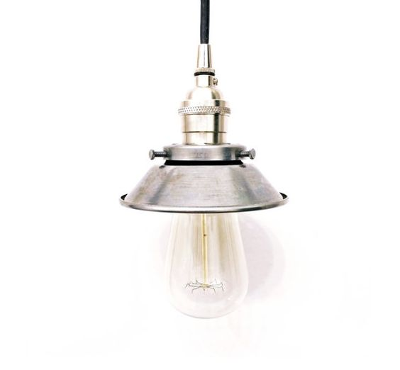 This is an industrial style pendant light made with a satin nickel socket, unfinished steel 4.75 cone shade, and satin nickel strain relief.