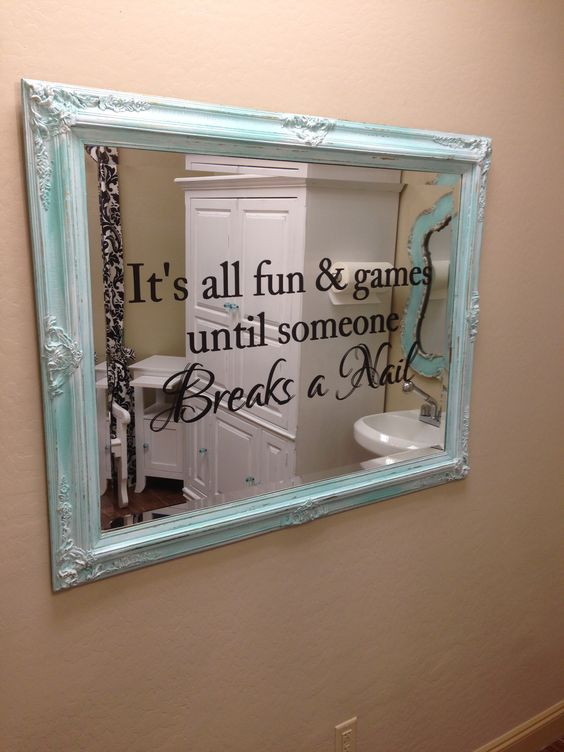 Distressed vintage mirror with fun nail salon saying added in vinyl lettering