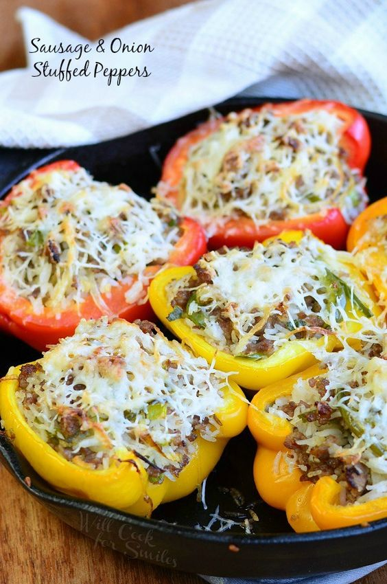 Delicious Stuffed Peppers made with with Italian sausage, onions, peppers and rice. Scrumptious dinner that is really easy to make and a great way to use leftover rice.